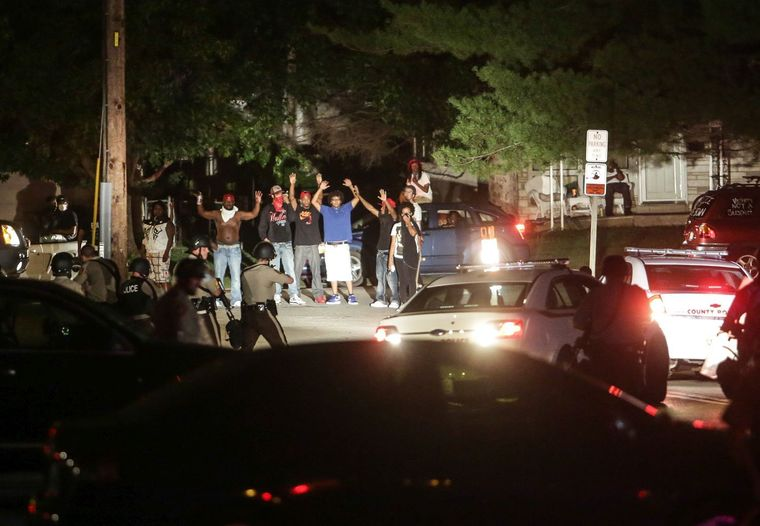 Police point guns at peaceful protesters in Ferguson (Lawrence Bryant/St. Louis American)