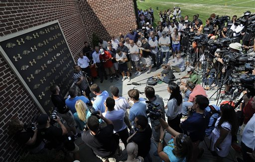 Baltimore Ravens running back Ray Rice, left, addressing the media at a news conference after NFL football training camp practice, Thursday, July 31, 2014, in Owings Mills, Md. (AP Photo/Gail Burton)