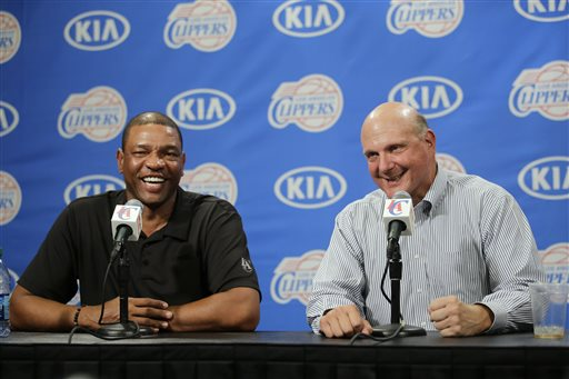 In this Aug. 18, 2014, file photo, new Los Angeles Clippers owner Steve Ballmer, right, and head coach Doc Rivers share a laughter during a news conference held after the Clippers Fan Festival in Los Angeles. Rivers is staying with the Los Angeles Clippers for another five years. In Ballmer's first big move since taking over as the team's new owner last week, he has locked in Rivers through the 2019 season. Ballmer said Wednesday, Aug. 27, 2014,  it was one of his top priorities to ensure that Rivers remains as the long-term leader of the team.  (AP Photo/Jae C. Hong, File)