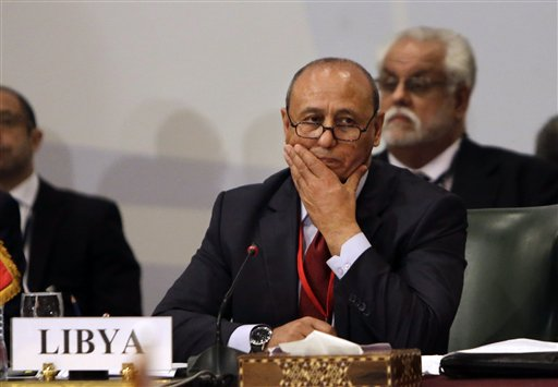 Libyan Foreign Minister Mohamed Abdelaziz, second left, attends a Cairo gathering of foreign ministers of Libya's neighbors in Cairo, Egypt, Monday, Aug. 25, 2014. Foreign ministers from Egypt Libya, Algeria, Tunisia, Sudan, and Chad, as well as the Arab League Secretary General, met Monday as weeks of inter-militia fighting has wreaked havoc in Libya. It's the worst violence in Libya since the 2011 downfall and killing of dictator Moammar Gadhafi. (AP Photo/Amr Nabil)