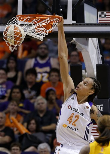 In this May 27, 2013, file photo, Phoenix Mercury's Brittney Griner dunks against the Chicago Sky in the second half during a WNBA basketball game in Phoenix. Griner brings her slam-dunking skills to Madison Square Garden for the first time, hoping to take her team a step closer to the WNBA playoffs and a possible league record 30-win season.  (AP Photo/Ross D. Franklin, File)