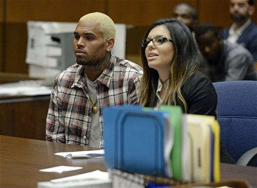 R&B singer Chris Brown appears with his attorney Setara Qassim at a probation progress hearing in Los Angeles Superior Court after he pleaded guilty to assaulting his then-girlfriend, Rihanna, Wednesday, Aug. 13, 2014.  (AP Photo/Kevork Djansezian, Pool)