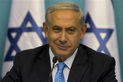 Israeli Prime Minister Benjamin Netanyahu smiles during a press conference at the prime minister's office in Jerusalem, Wednesday, Aug. 27, 2014.  Israel's prime minister declared victory Wednesday in the recent war against Hamas in the Gaza Strip, saying the military campaign had dealt a heavy blow and a cease-fire deal gave no concessions to the Islamic militant group.(AP Photo/Sebastian Scheiner)