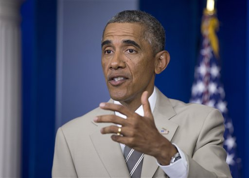 President Barack Obama speaks about the economy, Iraq, and Ukraine, Thursday, Aug. 28, 2014, in the James Brady Press Briefing Room of the White House in Washington, before convening a meeting with his national security team on the militant threat in Syria and Iraq. (AP Photo/Manuel Balce Ceneta)