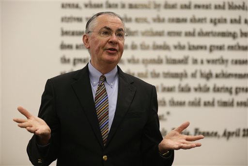 Wake Forest University president Nathan O. Hatch, chair of the NCAA board of directors,  gestures while speaking at NCAA headquarters in Indianapolis, Thursday, Aug. 7, 2014. The NCAA Board of Directors overwhelmingly approved a package of historic reforms Thursday that will give the nation's five biggest conferences the ability to unilaterally change some of the basic rules governing college sports. (AP Photo/Michael Conroy)