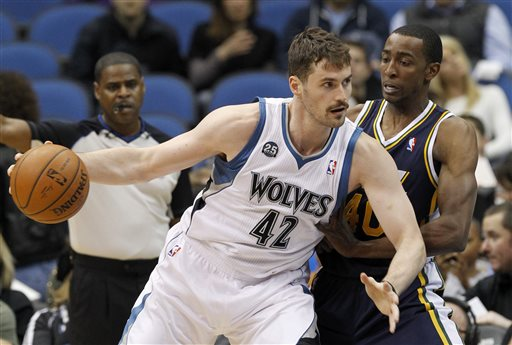 In this April 16, 2014 file photo, Minnesota Timberwolves forward Kevin Love (42) drives against Utah Jazz forward Jeremy Evans, right, during the first quarter of an NBA basketball game in Minneapolis. Two people with knowledge of the deal tell The Associated Press that Minnesota and Cleveland have agreed to a trade that will send All-Star forward Kevin Love to the Cavaliers for Andrew Wiggins, Anthony Bennett and a future first-round draft pick. The two people spoke Thursday on condition of anonymity because no official agreement can be reached until Aug. 23, when Wiggins, this year's No. 1 draft pick, becomes eligible to be traded. (AP Photo/Ann Heisenfelt, File)