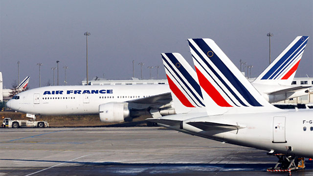 Air France planes are parked on the tarmac at Paris Charles de Gaulle airport, in Roissy, near Paris, in this Feb. 7, 2012 photo. (Christophe Ena/AP Photo)