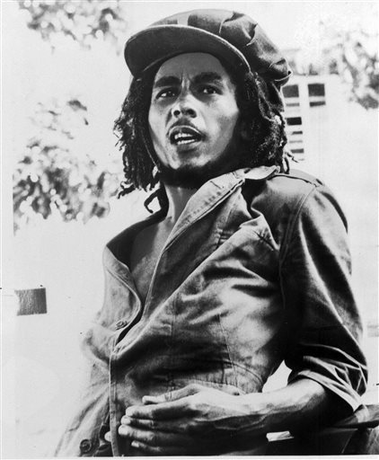 "This 1976 file photo originally released by Island Records shows Jamaican reggae singer Bob Marley. A musical about Bob Marley that uses the Jamaican reggae icon's music is in the works for next year. Center Stage in Baltimore said Tuesday it would present the world premiere of ""Marley,"" written and directed by company artistic director Kwame Kwei-Armah. It will play May 6 to June 14, 2015. (AP Photo/Island Records, File)"