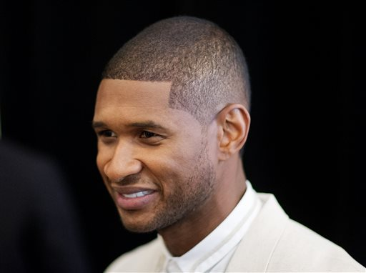 "R&B singer Usher attends the 15th anniversary celebration of his New Look Foundation, Thursday, July 31, 2014, in Atlanta. Usher felt overwhelmed by the amount of supporters at his New Look Foundation's 15th year anniversary luncheon. Legendary boxer Sugar Ray Leonard, director Kenny Leon and producer Jermaine Dupri were among the 450-plus attendees at foundation's President's Circle Awards luncheon in downtown Atlanta on Thursday. The nonprofit organization founded by the Grammy-winning singer also celebrated raising $1 million. ""This is a passion fuel for me,"" Usher said Thursday. (AP Photo/David Goldman)"
