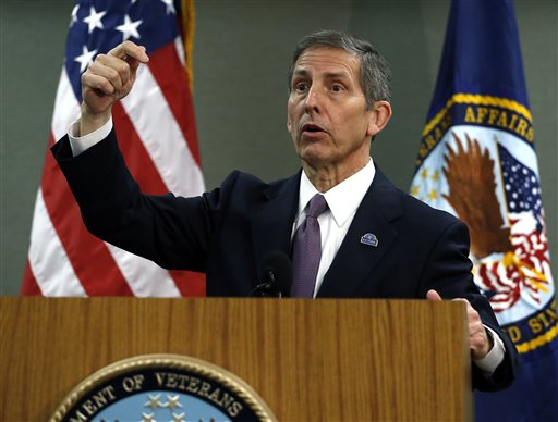 Deputy Veterans Affairs Secretary Sloan Gibson speaks during a press conference during a visit to a Denver veterans hospital, Wednesday Aug. 6, 2014. Gibson said that the VA's scheduling problems and personnel investigations can be cleared up in two years. (AP Photo/Brennan Linsley)