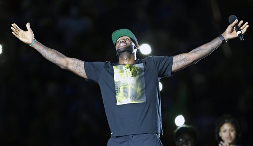 Cleveland Cavaliers' LeBron James smiles as he is introduced at his homecoming at InfoCision Stadium Friday, Aug. 8, 2014, in Akron, Ohio. (AP Photo/Tony Dejak)