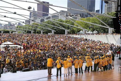 Members of the Jackie Robinson West All Stars Little League baseball team participate in a rally celebrating the team's U.S. Little League Championship Wednesday, Aug. 27, 2014, in Chicago. (AP Photo/Charles Rex Arbogast)