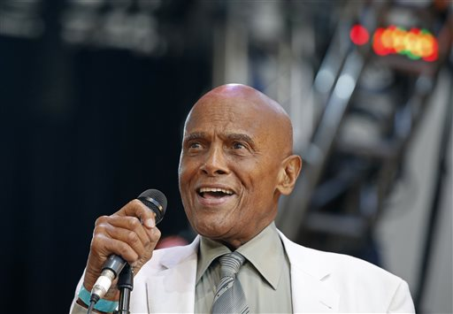 In this July 20, 2014 file photo, singer and activist Harry Belafonte speaks during a memorial tribute concert for folk icon and civil rights activist Pete Seeger at Lincoln Center's Damrosch Park in New York. Belafonte and Maureen O'Hara are among those will be honored by the motion picture academy's board of governors. The academy said Thursday, Aug. 28, 2014, that Belafonte will receive the Jean Hersholt Humanitarian Award at the academy's sixth annual Governors Awards on Nov. 8 in Los Angeles. (AP Photo/Kathy Willens, file)