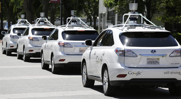 Google self-driving cars are parked May 14 outside the Computer History Museum in Mountain View, Calif. (AP photo)