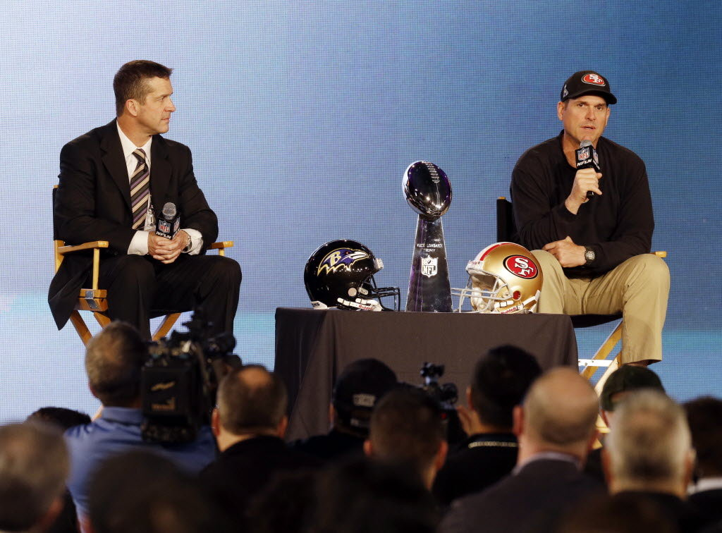 San Francisco 49ers coach Jim Harbaugh and Baltimore Ravens coach John Harbaugh participate in a news conference for Super Bowl XLVII today in New Orleans.San Francisco 49ers coach Jim Harbaugh and Baltimore Ravens coach John Harbaugh participate in a news conference for Super Bowl XLVII today in New Orleans. (Mark Humphrey/AP Photo)
