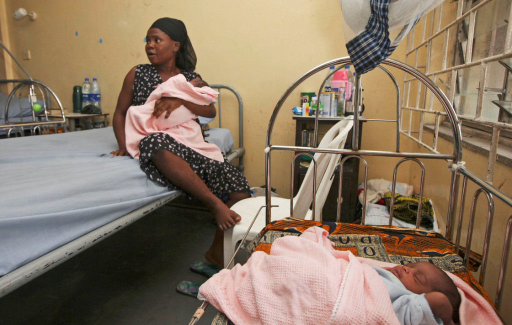 Seun Dupe sits with her newborn twins in a maternity hospital in Lagos, Nigeria. Nigeria is Africa's most populous country with more than 160 million people. UNICEF estimates that number will swell to nearly 1 billion by 2100. (Sunday Alamba/AP)