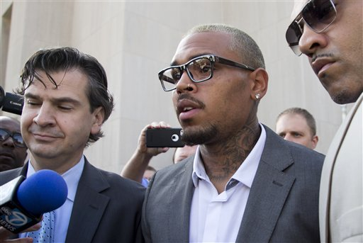 Singer Chris Brown, center, leaves District of Columbia Superior Court in Washington, Tuesday, Sept. 2, 2014, after pleading guilty on a misdemeanor assault. Brown pleaded guilty on Tuesday to hitting a man outside a Washington hotel, an assault that occurred while the singer was on probation for attacking his then-girlfriend Rihanna. Brown pleaded guilty to misdemeanor assault and was sentenced to time served. He spent two days in a District of Columbia jail in this case. (AP Photo/Manuel Balce Ceneta)