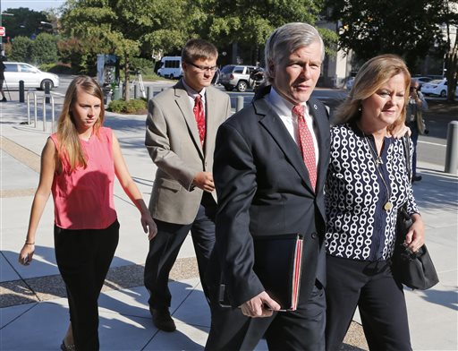 Former Virginia Gov. Bob McDonnell, second left, talks to his sister Eileen Reinamanas they arrive at federal court for the third day of jury deliberations in his corruption trial in Richmond, Va., Thursday, Sept. 4, 2014. McDonnell and his wife Maureen are charged in a 14-count indictment with doing special favors for Jonnie Williams, the CEO of dietary supplements maker Star Scientific Inc., in exchange for $165,000 in gifts and loans. (AP Photo/Steve Helber)