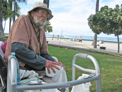 In this photo taken Monday Sept. 8, 2014, Jim Trevarthen, 62, watches the surfers near Waikiki Beach in Honolulu. Trevarthen is one of many homeless people who is unhappy with the city's proposals to ban sitting and lying down on sidewalks in the tourist mecca. Honolulu's city council is set to vote Wednesday on a sit-lie ban in Waikiki and Honolulu, aiming to keep homeless people out of sight after pressure from the tourism industry. (AP Photo/Cathy Bussewitz)
