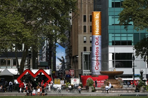 An inflatable cigarette is displayed to announce the drug store CVS' decision to stop selling cigarettes at its stores on Wednesday, Sept. 3, 2014, in New York. CVS announced Wednesday, Sept. 3, 2014 that it will tweak its corporate name. Rhode Island-based CVS Caremark will now be known as CVS Health, and stores will stop the sale of tobacco nearly a month sooner than planned. The cigars and cigarettes that used to fill the shelves behind store cash registers have been replaced with nicotine gum and other products that help people kick the tobacco habit. (AP Photo/Seth Wenig)
