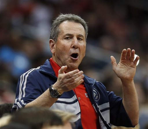 "In this April 26, 2014, file photo, Atlanta Hawks co-owner Bruce Levenson cheers from the stands in the second half of Game 4 of an NBA basketball first-round playoff series against the Indiana Pacers in Atlanta. Levenson said Sunday, Sept. 7, 2014, he is selling his controlling interest in the team, in part due to an inflammatory email he said he wrote in an attempt ""to bridge Atlanta's racial sports divide."" (AP Photo/John Bazemore, File)"