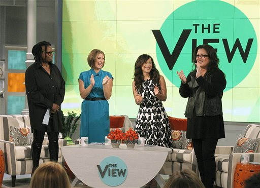 "In this image released by ABC, co-hosts, from left, Whoopi Goldberg, Nicolle Wallace, Rosie Perez and Rosie O'Donnell appear on the set of the daytime talk show ""The View,"" on Monday, Sept. 15, 2014 in New York. (AP Photo/ABC, Lou Rocco)"