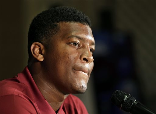 "In this July 20, 2014, file photo, Florida State's Jameis Winston answers a question during a news conference at the Atlantic Coast Conference Football kickoff in Greensboro, N.C.  Winston has made lewd comments about women and Florida State coach Jimbo Fisher says he is deciding whether to bench the Seminoles' quarterback for his ""derogatory"" remarks. Several students tweeted Winston stood on campus Tuesday and shouted a lascivious comment that may have derived from an internet meme. (AP Photo/Chuck Burton, File)"