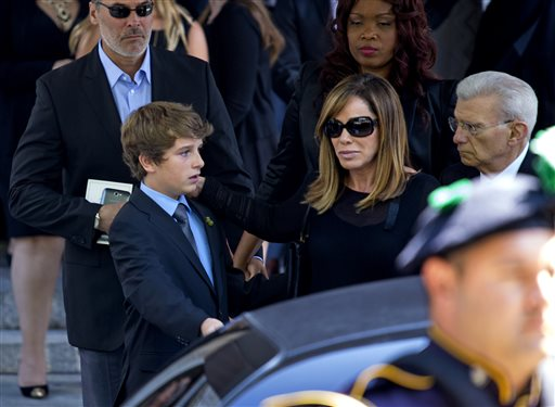 Melissa Rivers and her son Cooper Endicott walk to a waiting car after the funeral service for comedian Joan Rivers at Temple Emanu-El in New York Sunday, Sept. 7, 2014. Rivers died Thursday at 81. (AP Photo/Craig Ruttle)
