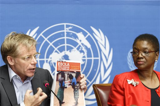 Bruce Aylward, left, Assistant Director-General of the World Health Organization, WHO, is sitting next to British Valerie Amos, right, United Nations Under-Secretary-General for Humanitarian Affairs and Emergency Relief Coordinator, as he holds a report on Ebola virus during a press conference about of the response on global aid pledged to fight the Ebola outbreak in west Africa, at the European headquarters of the United Nations in Geneva, Switzerland, Tuesday, Sept. 16, 2014. (AP Photo/Keystone, Salvatore Di Nolfi)