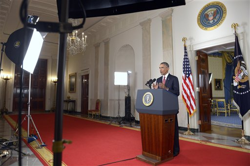 "President Barack Obama addresses the nation from the Cross Hall in the White House in Washington, Wednesday, Sept. 10, 2014. In a major reversal, Obama ordered the United States into a broad military campaign to ""degrade and ultimately destroy"" militants in two volatile Middle East nations, authorizing airstrikes inside Syria for the first time, as well as an expansion of strikes in Iraq.  (AP Photo/Saul Loeb, Pool)"