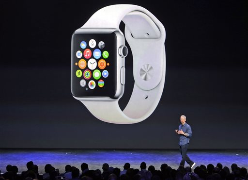 Apple CEO Tim Cook introduces the new Apple Watch on Tuesday, Sept. 9, 2014, in Cupertino, Calif. Apple's new wearable device marks the company's first major entry in a new product category since the iPad's debut in 2010. (AP Photo/Marcio Jose Sanchez)