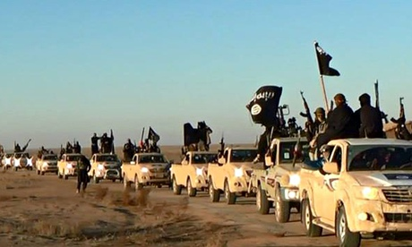 Isis fighters, pictured on a militant website verified by AP. (AP Photo)