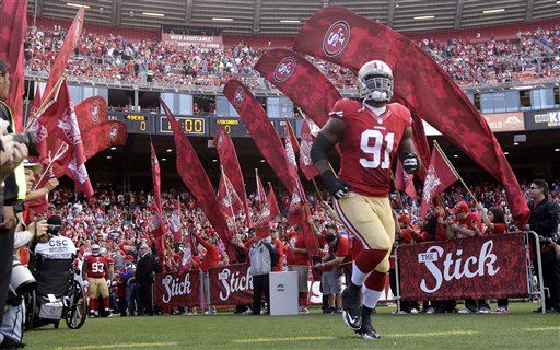 In this Aug. 25, 2013, file photo, San Francisco 49ers defensive tackle Ray McDonald (91) runs onto the field before an NFL preseason football game against the Minnesota Vikings in San Francisco. The NFL is allowing two more NFL players to continue playing while facing domestic violence issues. Similar to the Ray Rice case, the league says it investigating and waiting for the legal process to run its course before taking action. Carolina Pro Bowl defensive end Greg Hardy already has been convicted on two counts of domestic violence, but has filed an appeal. Ray McDonald of the 49ers also remains active while he is being investigated for abuse allegations. (AP Photo/Marcio Jose Sanchez, File)