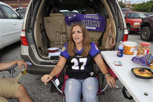 Holly Laucht, from Kent Island, Md., wears a Baltimore Ravens' Ray Rice jersey as she tailgates before the Ravens' NFL football game against the Pittsburgh Steelers on Thursday, Sept. 11, 2014, in Baltimore. (AP Photo/Gail Burton)