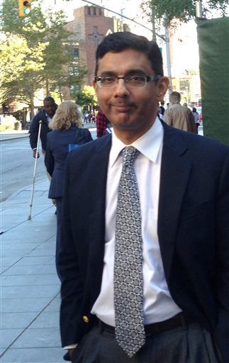 Dinesh D'Souza leaves federal court in New York, Tuesday, Sept. 23, 2014 after being sentenced to spend eight months in community confinement and undergo therapeutic counseling for arranging straw donors for a Senate candidate. D'Souza was spared from prison even though U.S. District Judge Richard M. Berman said the defendant continues to deflect responsibility and minimize his crime. (AP Photo/Larry Neumeister)