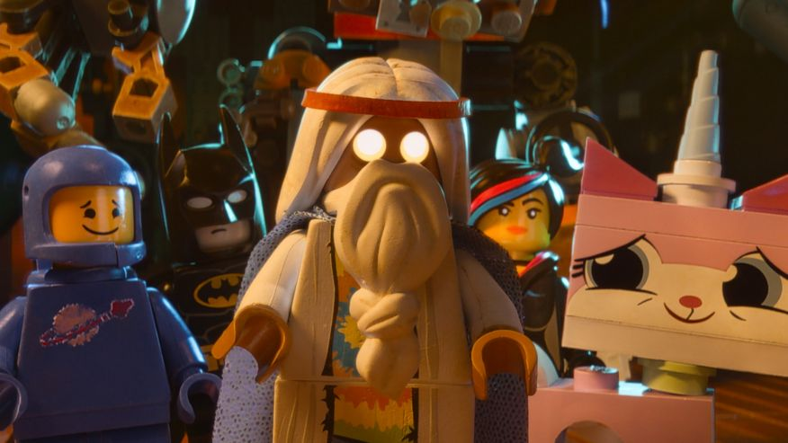 """Benny, voiced by Charlie Day, Batman, voiced by Will Arnett, Vitruvius, voiced by Morgan Freeman, Wyldstyle, voiced by Elizabeth Banks and Unikitty, voiced by Alison Brie, in a scene from """"The Lego Movie. (Associated Press)"""