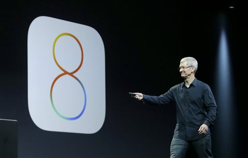 In this June 2, 2014 photo, Apple CEO Tim Cook speaks about iOS 8 at the Apple Worldwide Developers Conference in San Francisco. Apple has stopped providing an update to its new iOS 8 mobile operating software, following complaints by some users who said Wednesday, Sept. 24, 2014, that the update interferes with their ability to make phone calls. (AP Photo/Jeff Chiu, File)