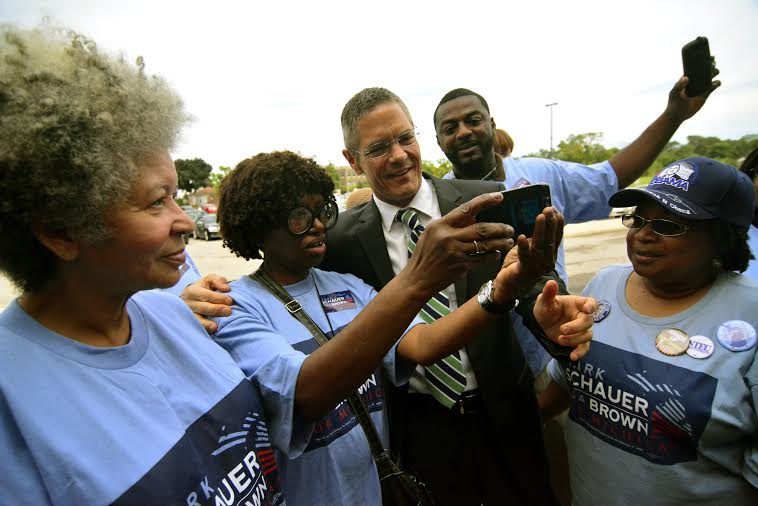 Valerie Glynn, Vera Magee and Glenda McGadney, (l-r) among Detroiters supporting Mark Schauer (center), the Democratic candidate for governor, snap selfies. (Dale Rich Photo)