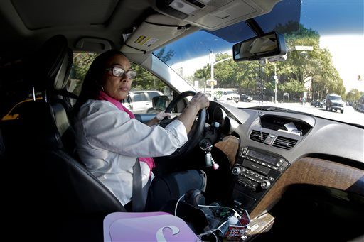 Dinorah De Cruz drives through Queens on her way to the SheRide livery office, Monday, Sept. 15, 2014, in New York. De Cruz is one of 100 women currently signed up to drive for SheRides, a car service by women drivers for women riders in New York City, Westchester County and Long Island. Less than 3 percent of the city's 115,000 licensed taxi, livery and limousine drivers are women, and that can be a problem for women who are reluctant to get into a cab alone with a male driver because of safety concerns or religious and social mores. (AP Photo/Julie Jacobson)