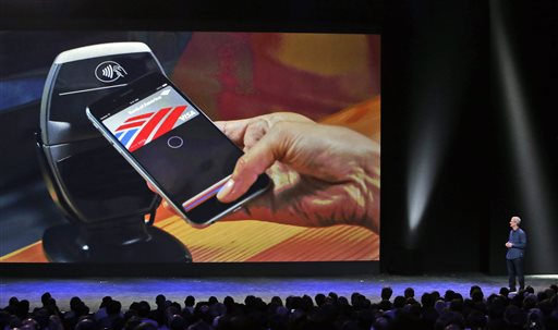 Apple CEO Tim Cook introduces the new Apple Pay product on Tuesday, Sept. 9, 2014, in Cupertino, Calif. (AP Photo/Marcio Jose Sanchez)