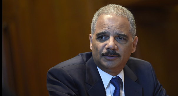 Attorney General Eric Holder speaks during an interview with The Associated Press at the Justice Department in Washington, Tuesday, Sept. 16, 2014. (AP Photo/Susan Walsh)
