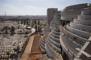 This Oct. 6, 2014, photo shows a new vertical part of the Yarkon cemetery outside of the city of Petah Tikva, Israel. With real estate at a premium, Israel is at the forefront of a global movement building vertical cemeteries in densely populated countries. The reality of relying on finite land resources to cope with the endless stream of the dying has brought about creative solutions. (AP Photo/Dan Balilty)