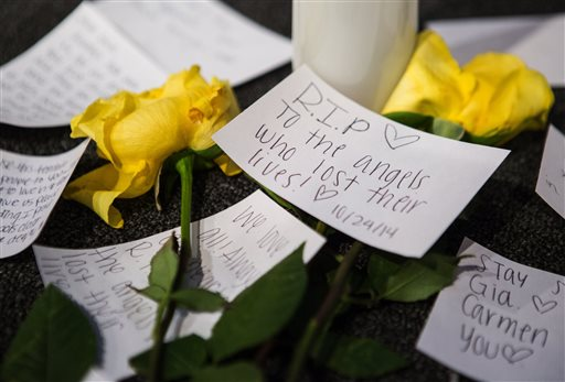 Messages of support on the stage near candles and flowers in between morning services at The Grove Church in Marysville, Wash., two days after the Marysville-Pilchuck High School shooting, on Sunday, Oct. 26, 2014. (AP Photo/The Seattle Times, Lindsey Wasson)