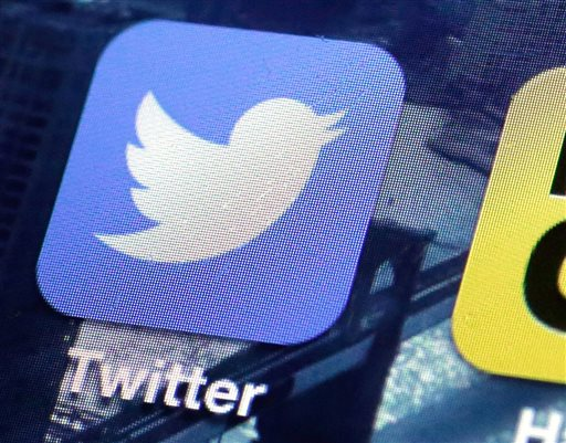 This Friday, Oct. 18, 2013, file photo shows a Twitter app on an iPhone screen, in New York. Twitter reports quarterly financial results on Monday, Oct. 27, 2014. (AP Photo/Richard Drew, File)