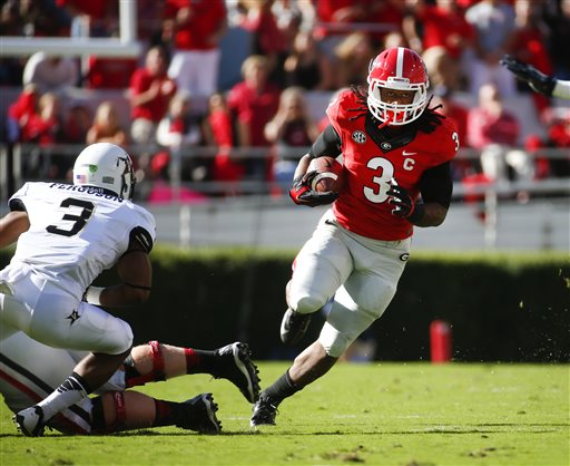 Georgia running back Todd Gurley (3) breaks free for a first down as Vanderbilt defensive back Taurean Ferguson (3) defends in the first half of an NCAA college football game Saturday, Oct. 4, 2014, in Athens, Ga. (AP Photo/John Bazemore)
