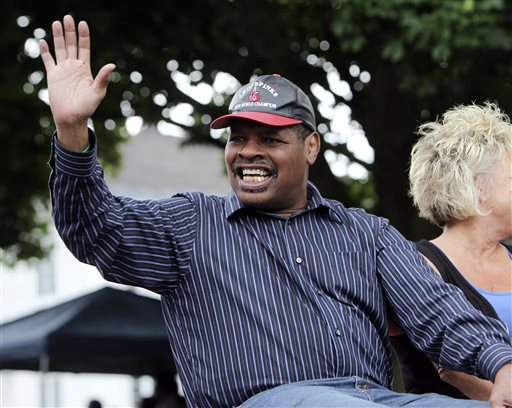 In this June 12, 2011, file photo, former heavyweight boxing champion Leon Spinks waves during a Boxing Hall of Fame parade in Canastota, N.Y. Leon Spinks is in a Las Vegas hospital after a second operation for abdominal problems. The 61-year-old boxer who catapulted to fame by beating Muhammad Ali in 1978 had the second surgery in recent days after complications from the first emergency surgery. (AP Photo/Mike Groll, File)
