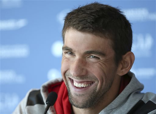 In this Aug. 20, 2014, file photo, U.S. swimmer Michael Phelps laughs during a press conference ahead of the Pan Pacific swimming championships in Gold Coast, Australia. Authorities say Phelps has been arrested on a DUI charge in Maryland. Transit police say they stopped the 29-year-old Phelps at the Fort McHenry Tunnel in Baltimore around 1:40 a.m. Tuesday, Sept. 30, 2014. (AP Photo/Rick Rycroft, File)