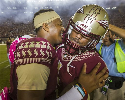 Florida State quarterback Jameis Winston, left, celebrates the team's 31-27 victory over Notre Dame with teammate Ermon Lane after an NCAA college football game in Tallahassee, Fla., Saturday, Oct. 18, 2014.  AP Photo/Mark Wallheiser)