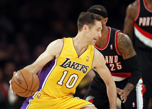 In this April 1, 2014, file photo, Los Angeles Lakers guard Steve Nash (10) drives around Portland Trail Blazers guard Mo Williams during the first half of an NBA basketball game in Los Angeles. The Lakers announced Thursday, Oct. 23, 2014, that Nash has been ruled out for the upcoming season with a back injury, putting the two-time NBA MVP's career in doubt. (AP Photo/Danny Moloshok, File)