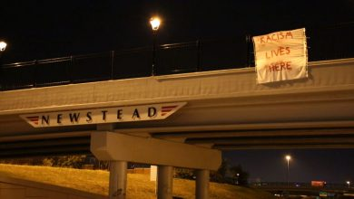 Photo of Protestors Hang More Than 40 Banners on Highway Overpasses